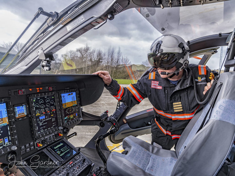 Yorkshire air ambulance pilot climbing into helicopter commercial photography